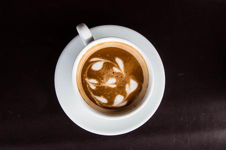 coffee on black background Фото со стока