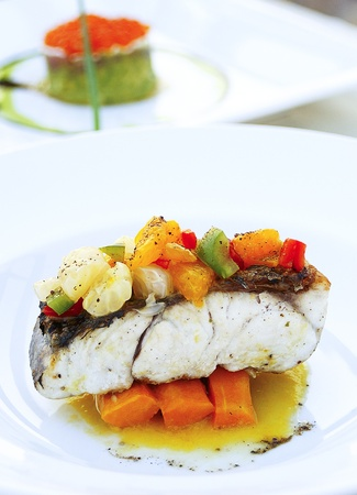 snow fish with carrot and sauce Stock Photo - 13451606