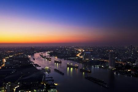 river scape: Chao Phraya river twilight and city scape Editorial