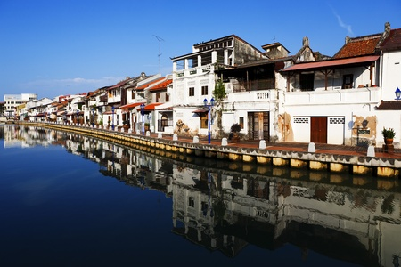 dwell: Malacca city with house near river under blue sky in Malaysia Editorial