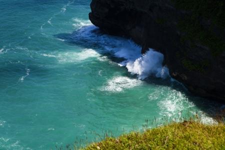 Rock sea and wave Pura Uluwatu temple, Bali Indonesia