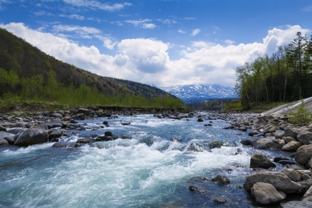 Streaming river from mountains  in Hokkaido, Japan