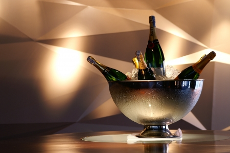 gold capped: Bottle of champagne in bucket