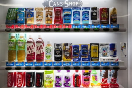 coffee tea and juice cans and bottle in vending machine in japan