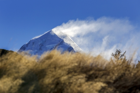newzealand: snow blowing over the top of Mount Cook at Mount Cook National Park, Canterbury, New Zealand