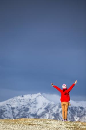 Young happy woman standing on Mt,John, Tekapo, Canterbury, New Zealand