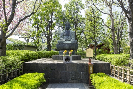 Buddha statue in the garden of Asakusa temple area Editorial