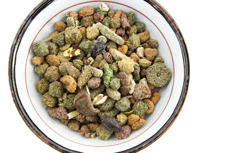 whitem: Pet food for guinea pigs or cavy in the bowl on white background