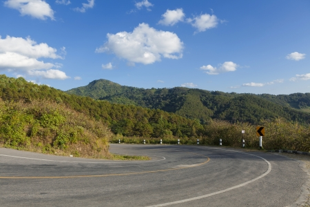 Asphalt road sharp curve on the mountain photo