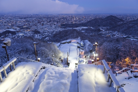 View twilight time on top of ski jump in Sapporo city, Hokkaido, Japan photo