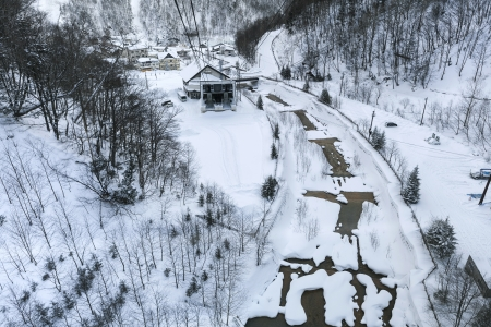 Aerial view of small creek in winter photo