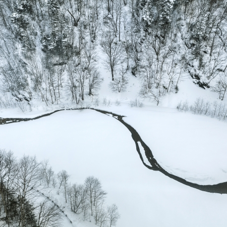 Top view of small creek in winter photo