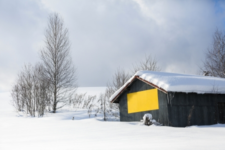 Japanese barn with snow on the roof, Hokkaido, Japan photo