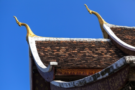 Architecture detial on roof at Wat Xieng thong temple in Luang Pra bang, Laos photo