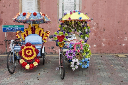 trishaw: Trishaw decorated with colorful flowers in Malacca, Malaysia