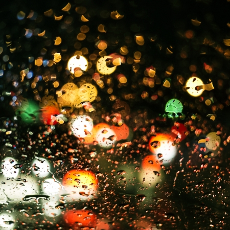 rain drops on car glass in rainy night