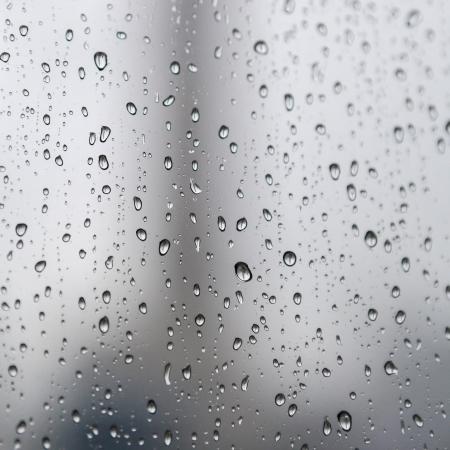 Rain drops on the glass in rainy days photo