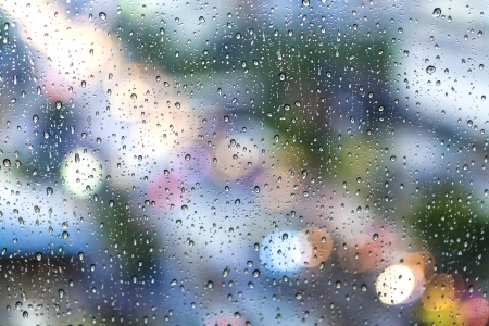 Rain drops on the glass in rainy days