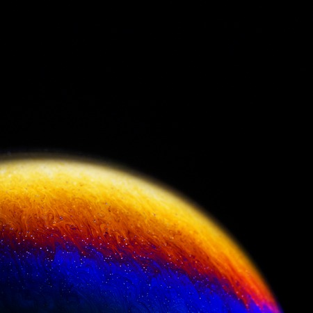 Close up of colorful soap bubble abstract over black background photo