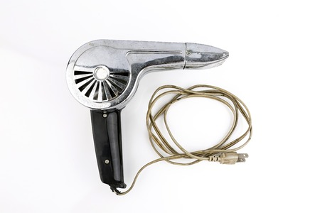 Old hairdryer on the white background photo