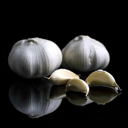 garlic on black background Stock Photo