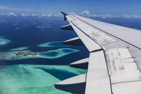 pristine corals: Arplane fly over Atolls in Indien Ocean Stock Photo