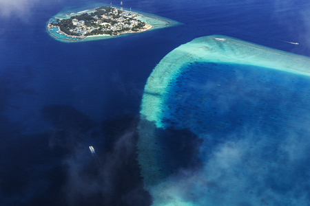Aerial View from seaplane over Atolls at Indien Ocean, Maldives