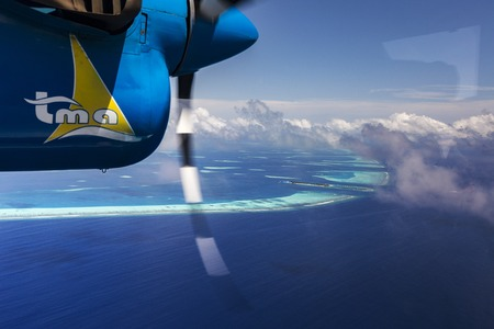 hydroplane: Indien Ocean Malddives - June 14, 2015 : Seaplane taxi fly over Atolls in Indien Ocean To transfer passengers to the hotel in the islands.
