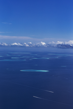 Group of atolls in Maldives from seaplane view