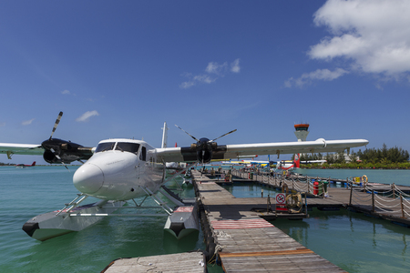 Male Maldives - June 14, 2015 : Seaplane harbor of any Maldivian airways operating out of Ibrahim Nasir airport in Male, Maldives, provides services to several island resorts Sajtókép
