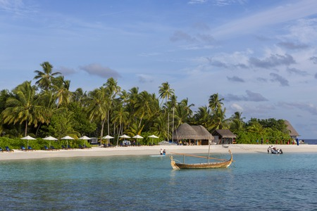 Male Maldives - June 14, 2015 : Locals and tourists relax on city beach. This is the only artificial beach in Maldives