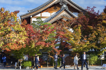 changing color: KYOTO, JAPAN - 20 NOVEMBER 2015:Visitors tour the beauty of leaves changing color in the Eikando Zenrin-ji temple.The temple very famous for its autumn colors