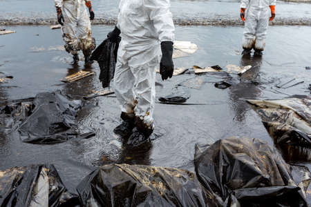 Crude oil on oil spill is accident on a beach at Ao Prao Beach, Koh Samet, Rayong, Thailand