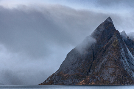 Olstinden mountain peak in Skandia.It is located on the shore of Kjerkfjorden in Hamnoy village at Lofoten island, Norway