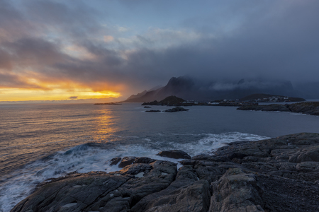 Sunset over the sea take a photo from Hamnoy village in Lofoten islands, Norway Stock Photo