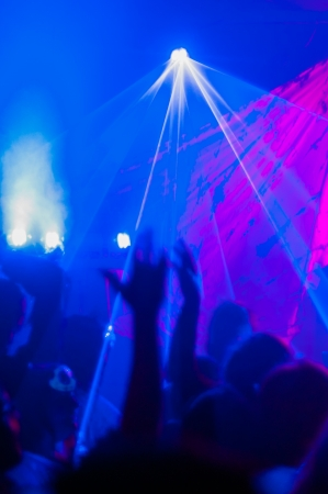 dancing club: Young adults partying in a nightclub  Stock Photo