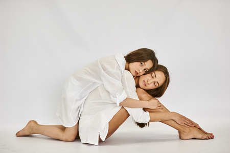 relations between generations. mother and daughter love. white background Stockfoto