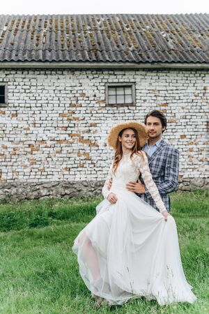 A young couple of brides have a fun and walking in the field outdoor