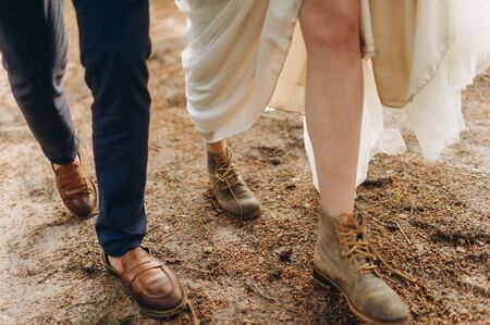 A young couple of brides walking in the pine forest 写真素材 - 129459714