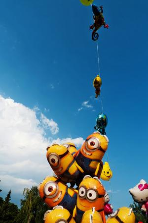 sales person: Children balloons on open air market