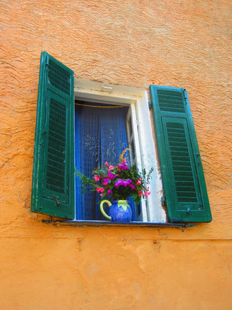 window shades: Window in Italy with flowers