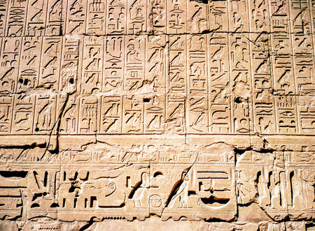 Egyptian hieroglyphs and  Relief in Luxor,Egypt 写真素材