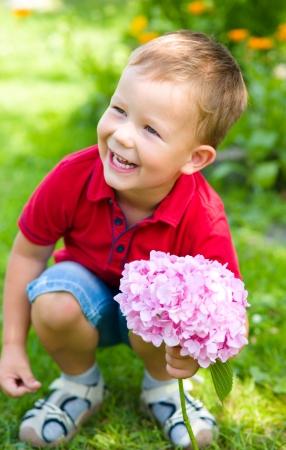 ��beautiful boy�: Little beautiful boy with flowers Stock Photo