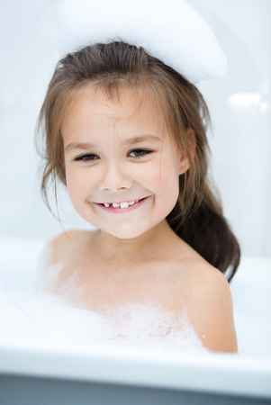 bathwater: Cute girl bathes in a bathroom Stock Photo
