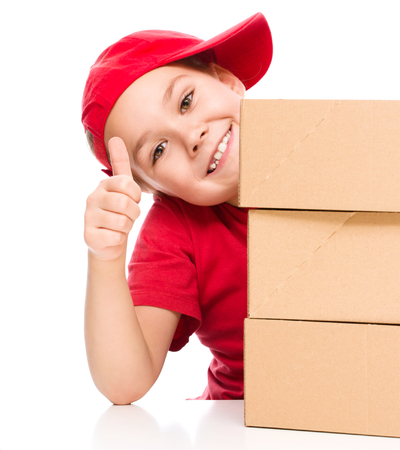 Happy girl holding cardboard boxes, delivery of goods, isolated over white