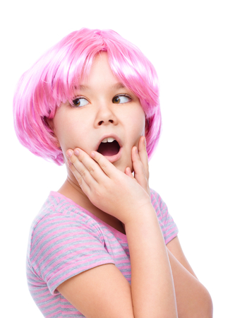 astounded: Cute girl is holding her face in astonishment and looking up, isolated over white