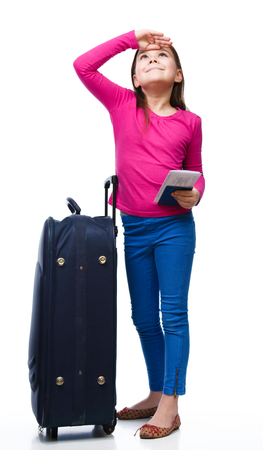 Tourism, vacation concept - smiling girl with travel bag, ticket and passport, isolated over white Stock Photo