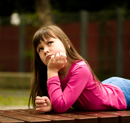 astounded: Cute girl is holding her face in astonishment and looking up