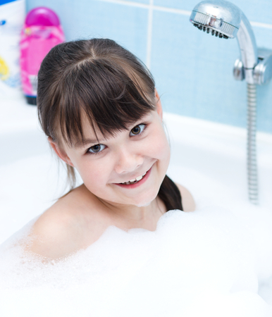 bathwater: Cute girl bathes in a bathroom Stock Photo