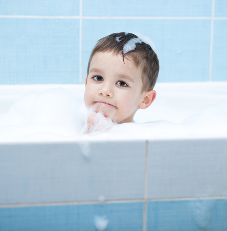 bathwater: Small child bathes in a bathroom Stock Photo